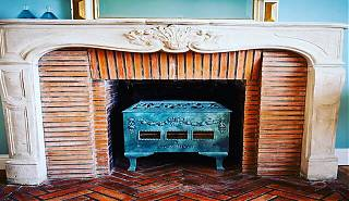 Fireplace with blue wood burner.