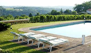 Pool with four sun loungers and clos mirabel vineyard views.